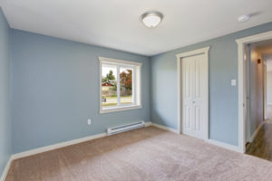 Light blue bedroom with closets